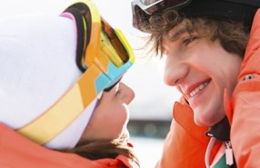 Close-up of romantic young couple about to kiss during winter
